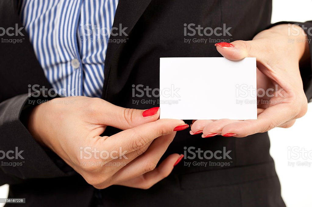 Businesswoman's hands holding blank business card stock photo