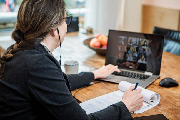 Businesswoman's Home Office Set Up for Webinar and Teleconference stock photo