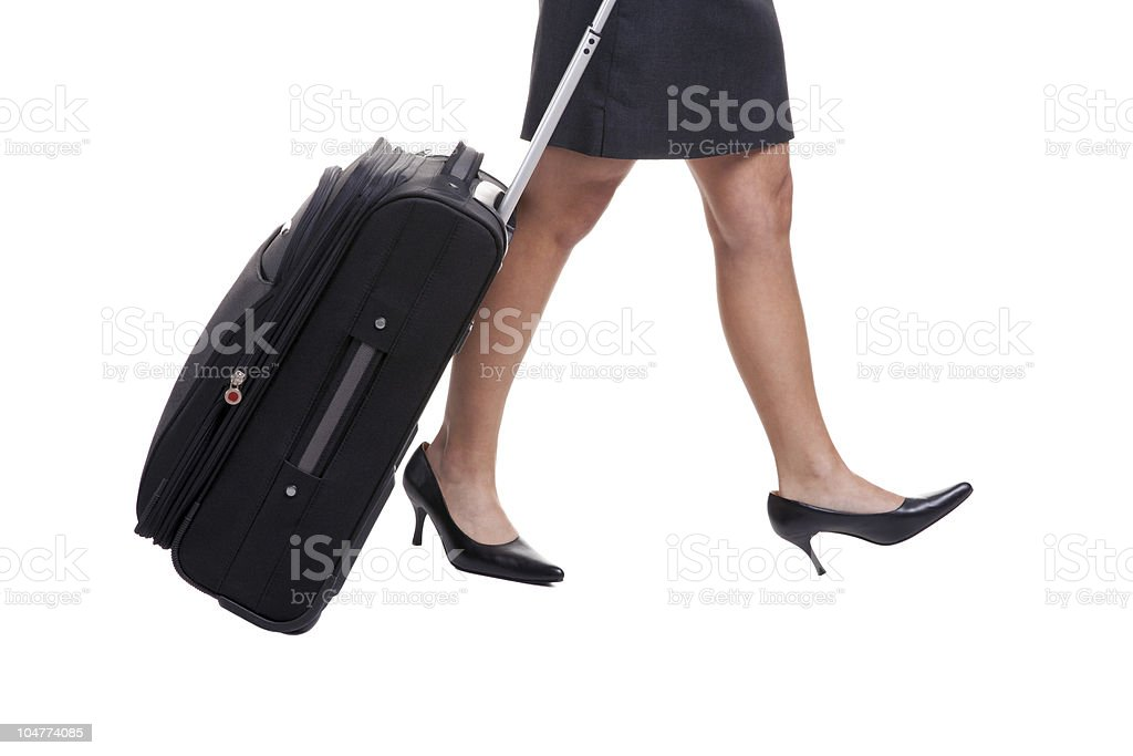 Businesswomans legs with suitcase royalty-free stock photo