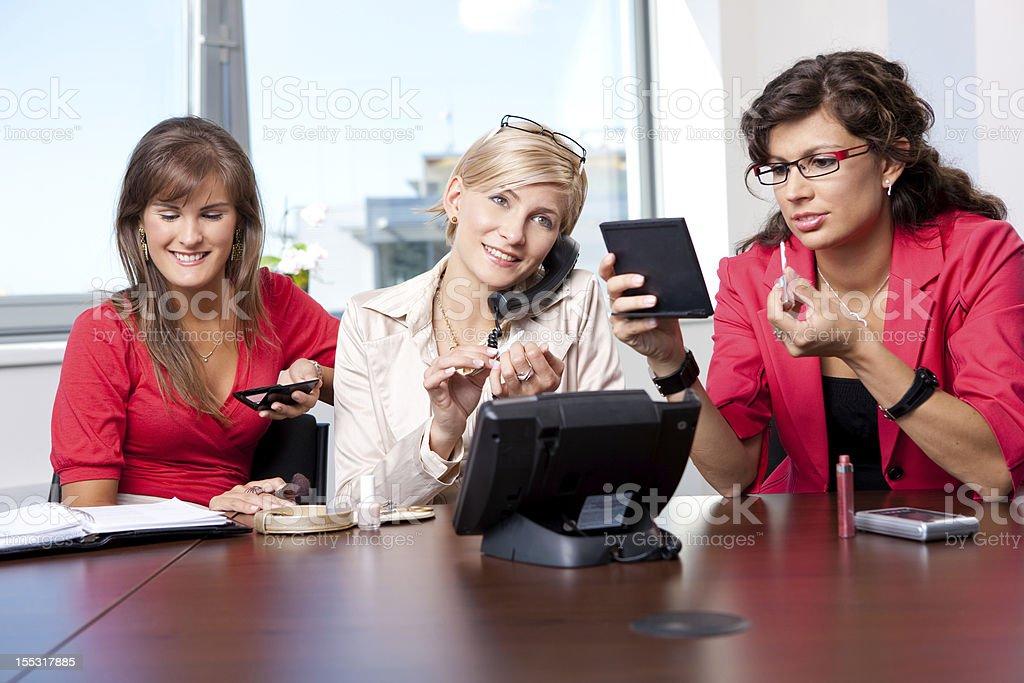 Businesswomen adjusting makeup royalty-free stock photo
