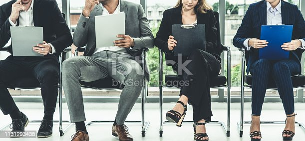 587228412istockphoto Businesswomen and businessmen wait for interview. 1131293438