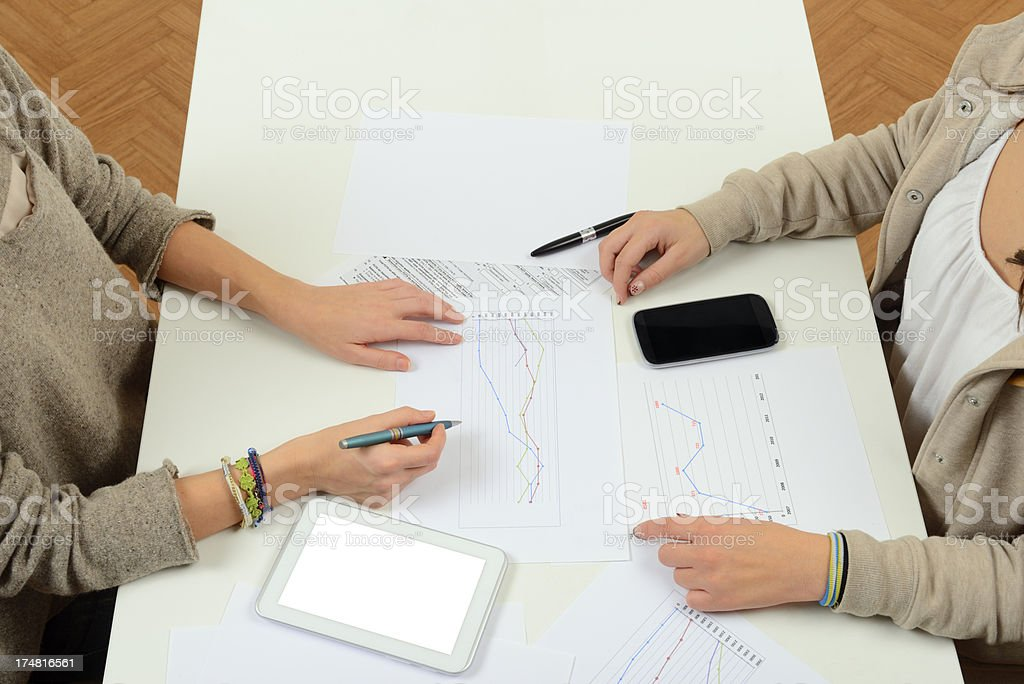 Businesswomen and Investment W Digital Tablet royalty-free stock photo