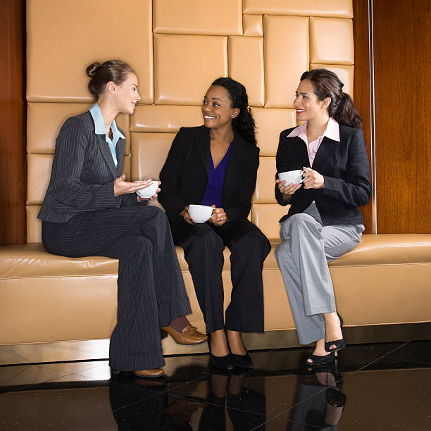 Businesswomen drinking coffee. stock photo