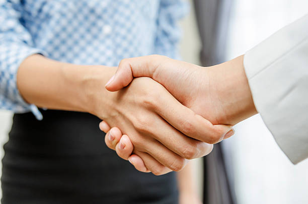Businesswomen handshake stock photo