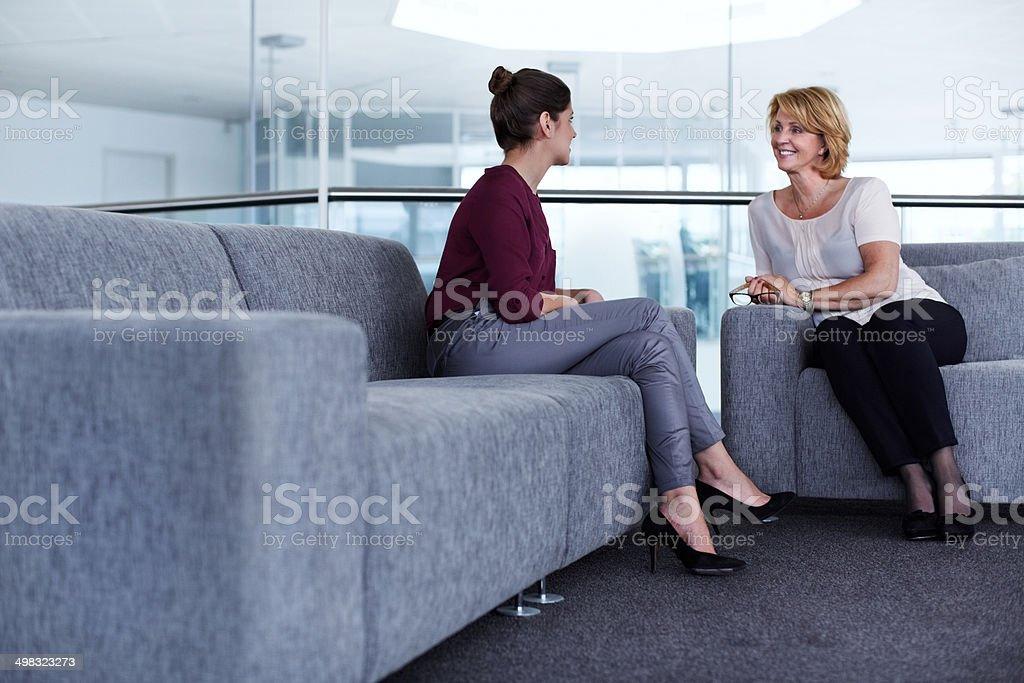 Businesswomen having casual discussion stock photo