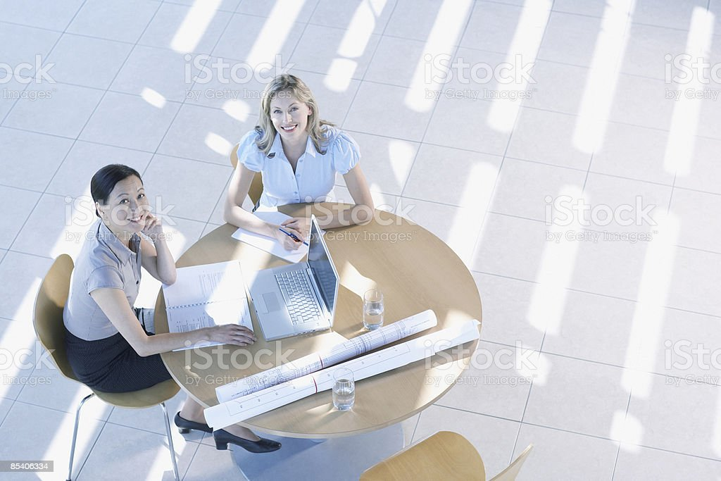Businesswomen having meeting in lobby royalty-free stock photo