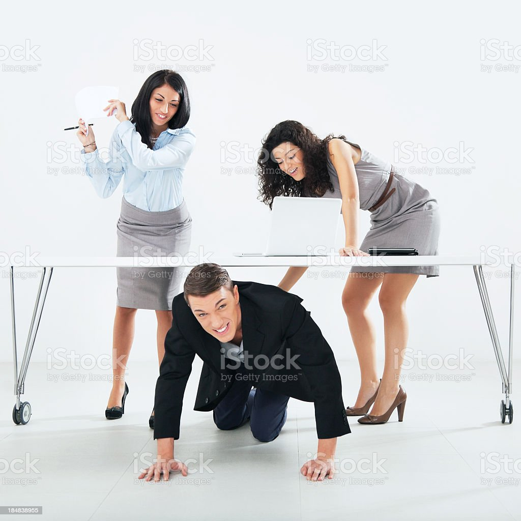 businesswomen hitting male colleague royalty-free stock photo