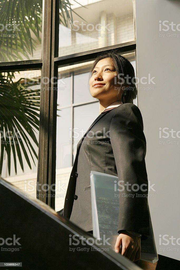 businesswomen holding folder royalty-free stock photo