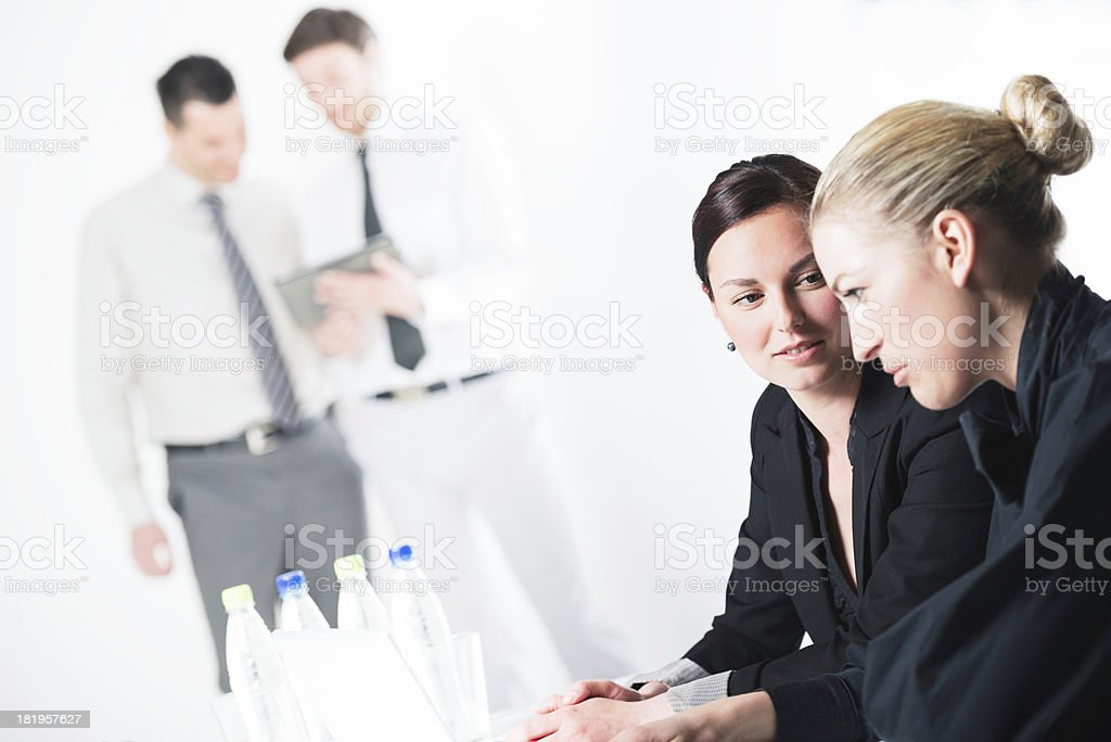 Businesswomen in foreground and businessmen in background royalty-free stock photo