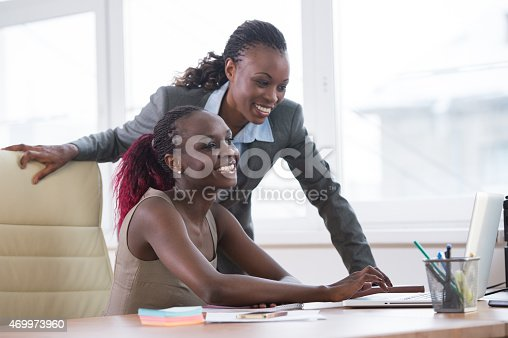 istock Businesswomen in office working on a project together 469973960