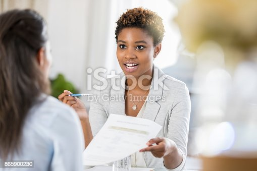 istock Businesswomen meet to discuss document 865900230