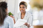 istock Businesswomen meet to discuss document 865900230