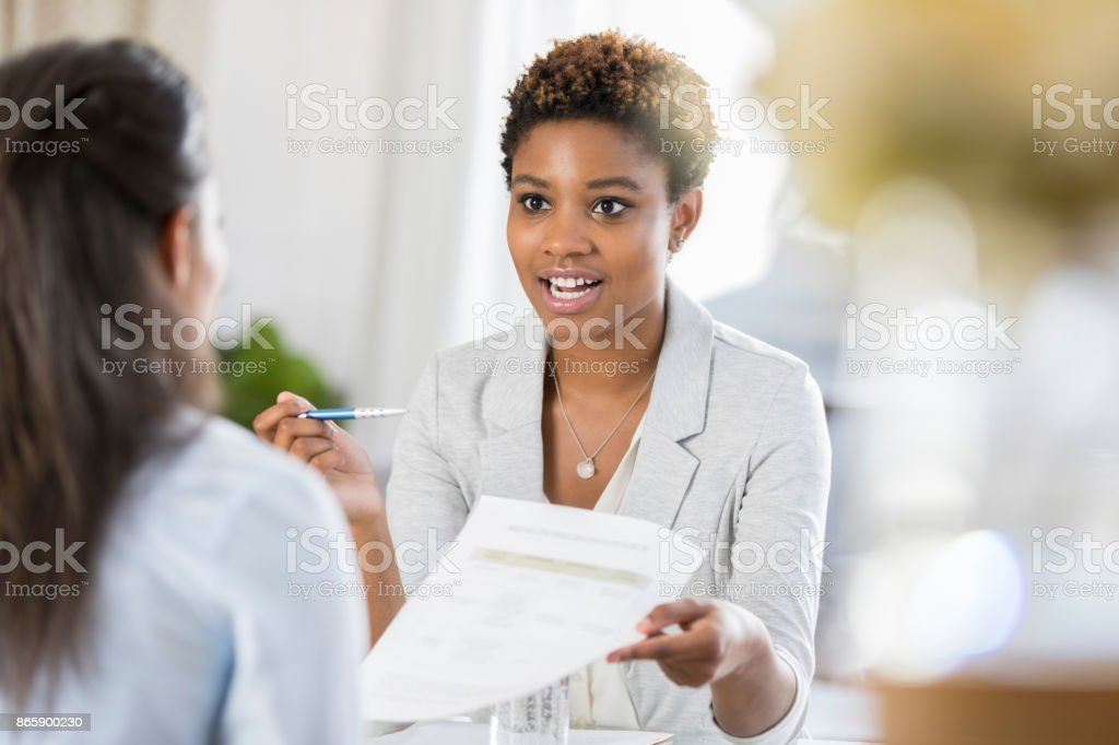Businesswomen meet to discuss document - foto stock