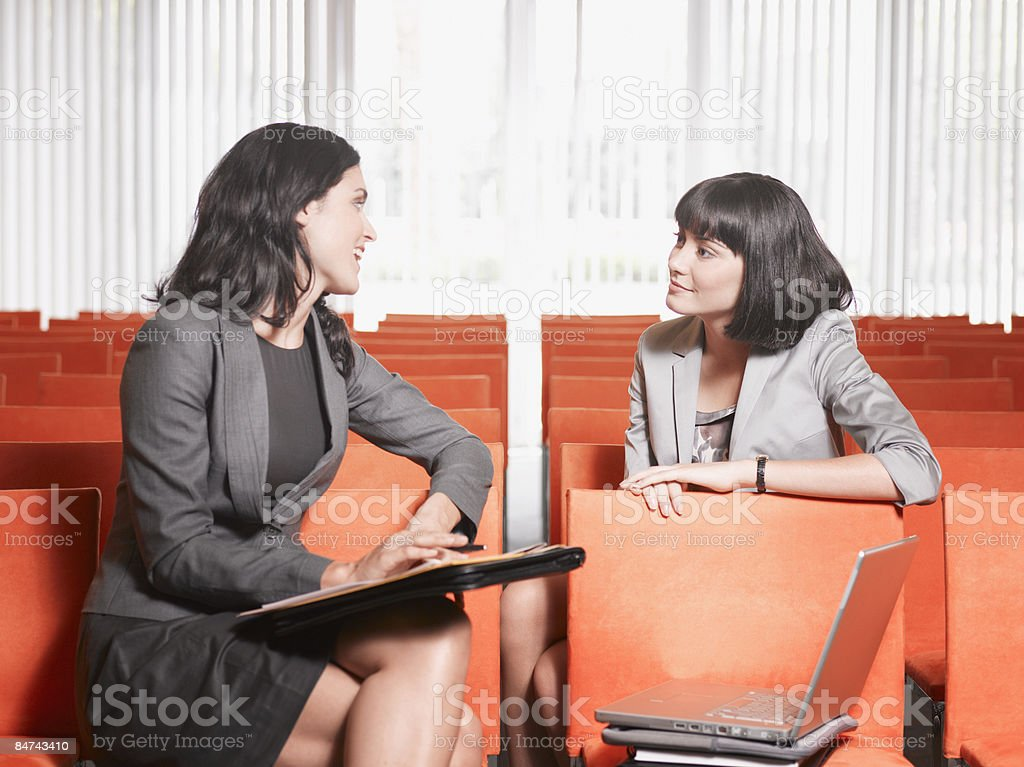 Businesswomen meeting in lecture hall royalty-free stock photo