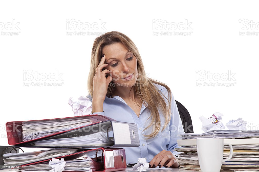 Businesswomen over-worked woman at desk. royalty-free stock photo