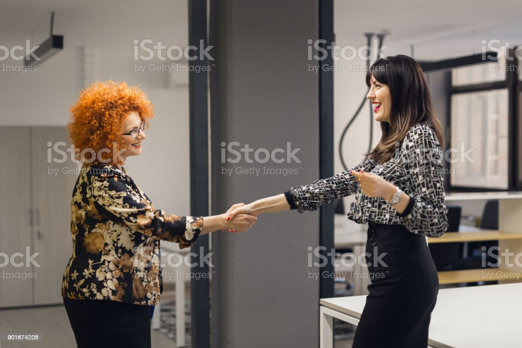 Businesswomen shake hands stock photo