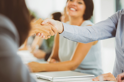 Businesswomen Shaking Hands Stock Photo - Download Image Now