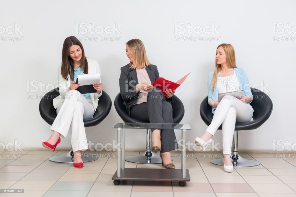 Businesswomen sitting and waiting for job interview stock photo