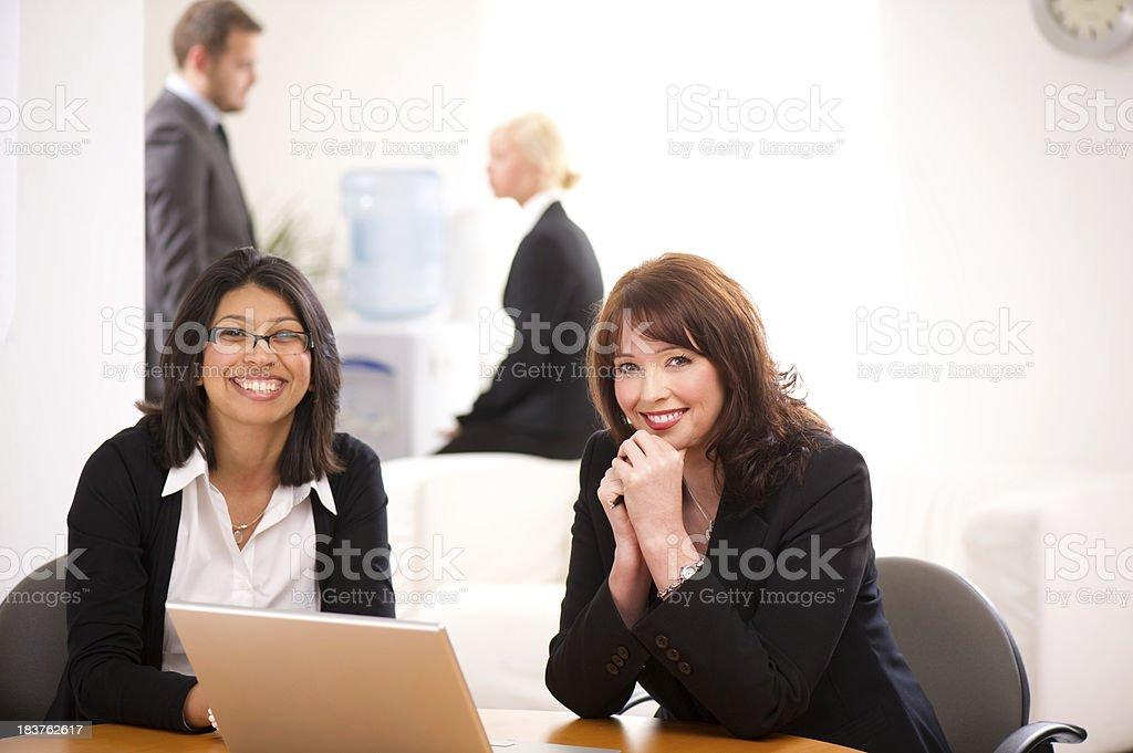 businesswomen smile to camera royalty-free stock photo