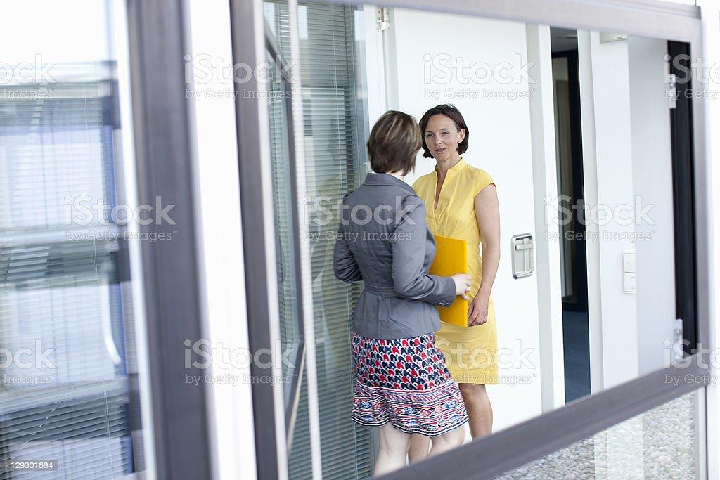 Businesswomen talking in office royalty-free stock photo