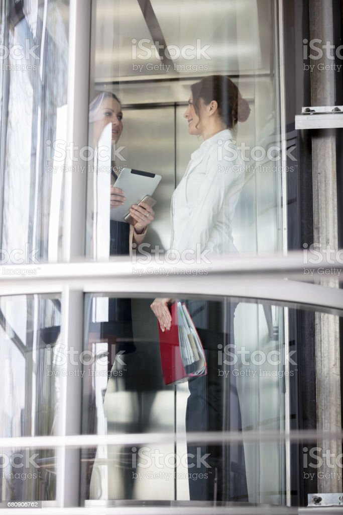 Businesswomen talking in office royalty-free stock photo