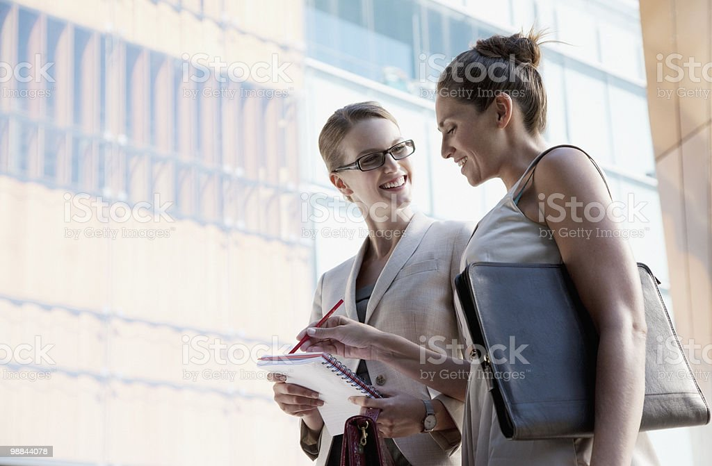 Businesswomen talking outdoors royalty-free stock photo