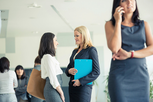 Businesswomen Talking Together In An Office Stock Photo - Download Image Now