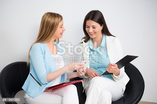 995734014istockphoto Businesswomen waiting for a meeting with executive 681965252