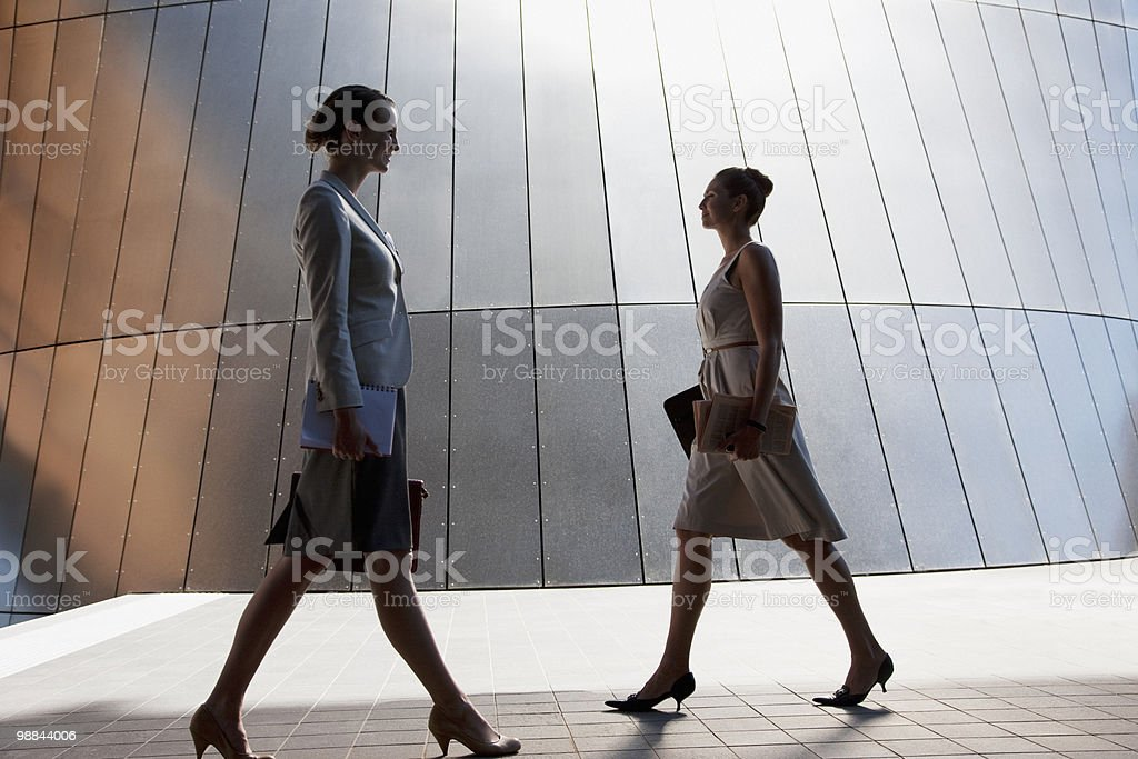 Businesswomen walking outdoors royalty-free stock photo