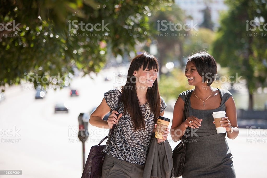 Businesswomen walking together outdoors royalty-free stock photo