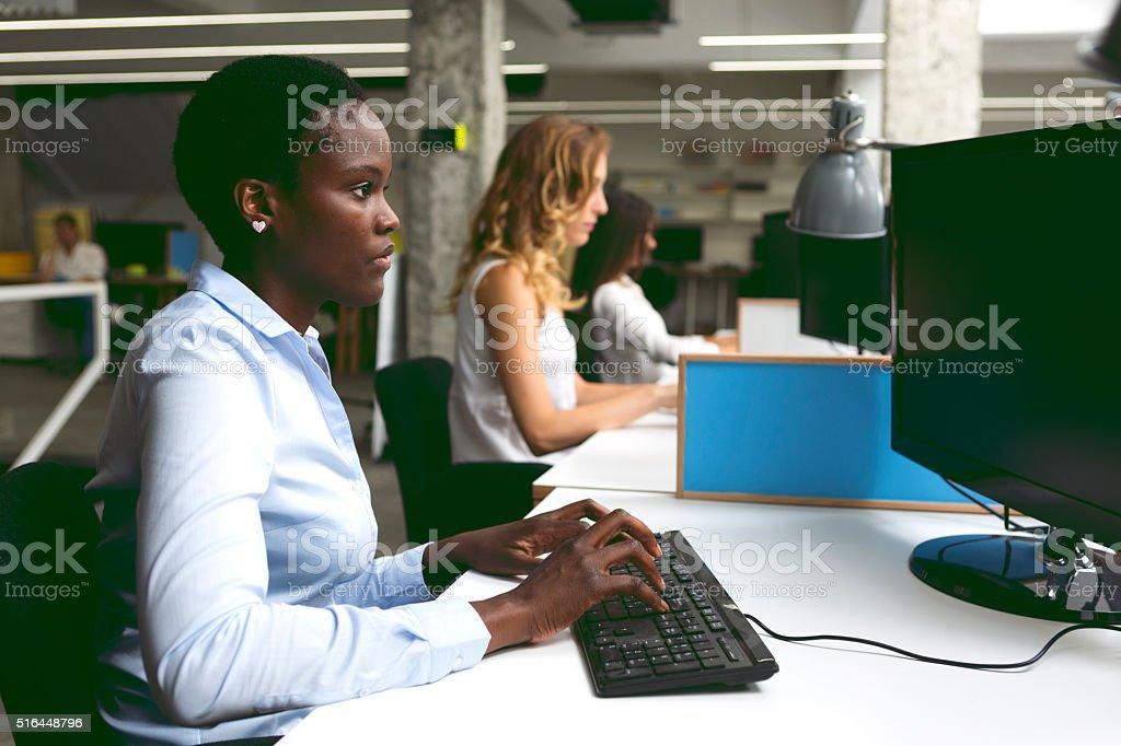Businesswomen working at call center. stock photo