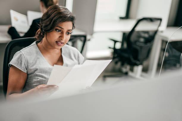 Businesswomen working at her desk stock photo