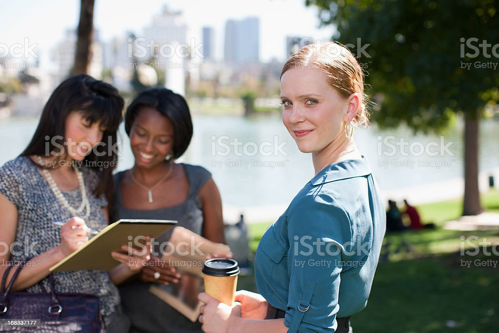 Businesswomen working in park royalty-free stock photo