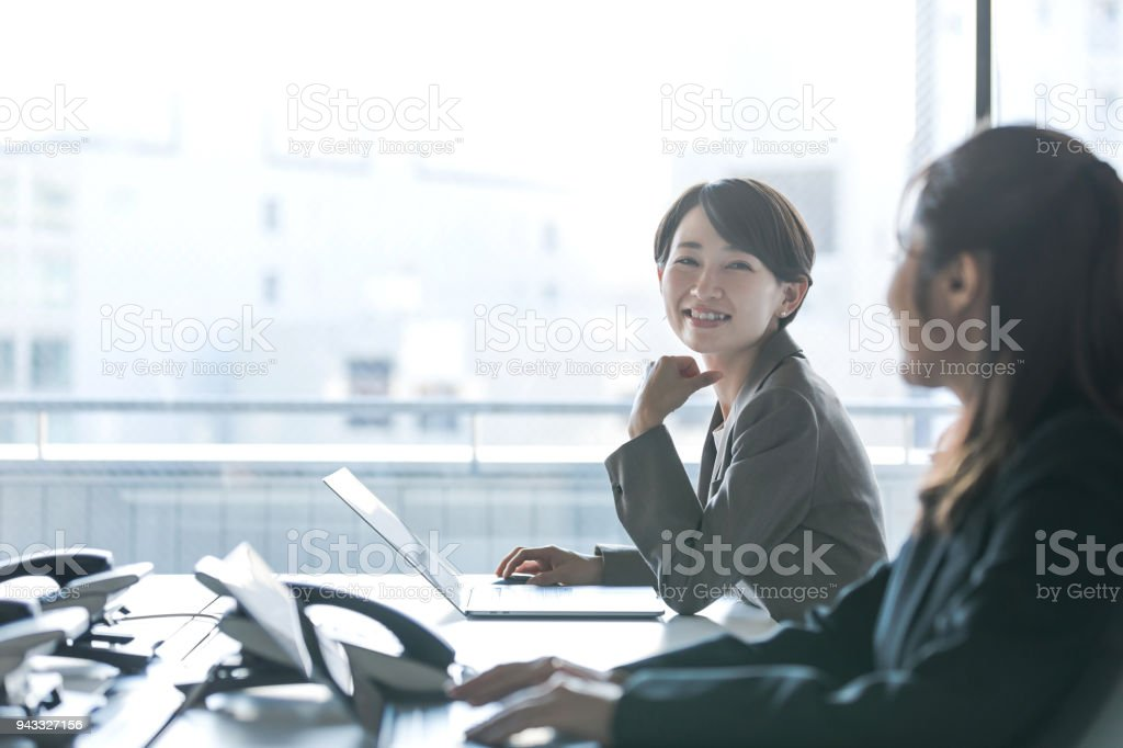 Businesswomen working in the office. Positive workplace concept. stock photo