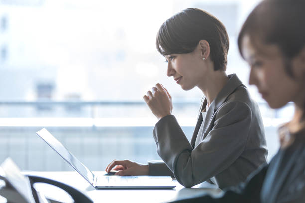 Businesswomen working in the office. Positive workplace concept. Businesswomen working in the office. Positive workplace concept. japanese ethnicity stock pictures, royalty-free photos & images