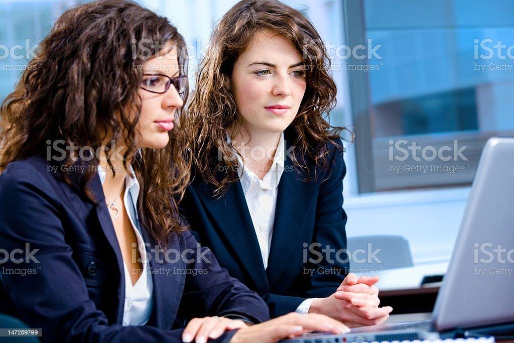 Businesswomen working on computer royalty-free stock photo