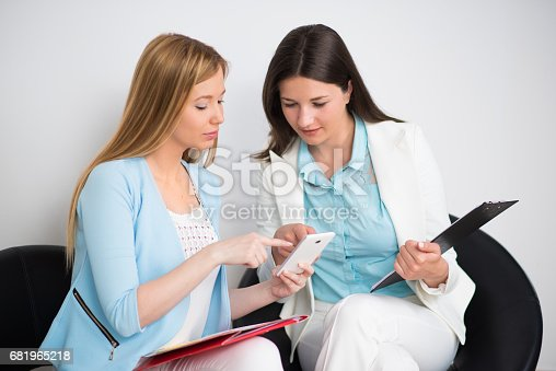 995734014istockphoto Businesswomen working together in office 681965218