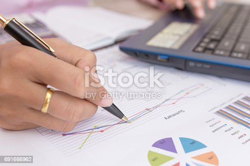 istock Businesswomen working with graph data at office,Finance managers task,Concept business and finance 691666962