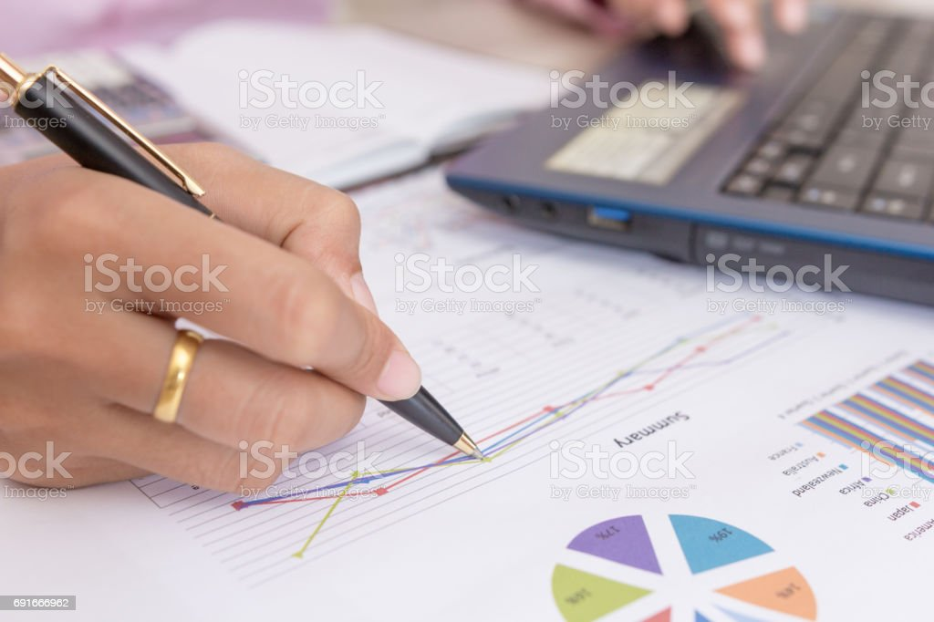 Businesswomen working with graph data at office,Finance managers task,Concept business and finance stock photo