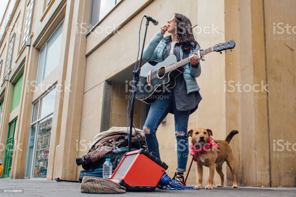 Busker And Her Dog stock photo