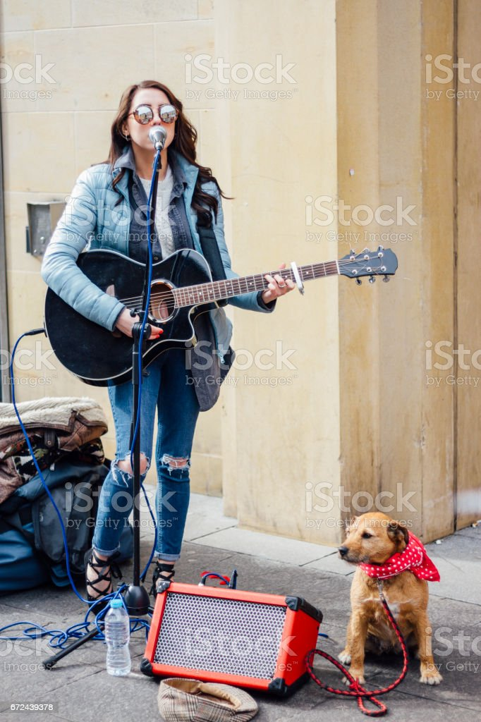 Busker And Her Dog - foto de stock