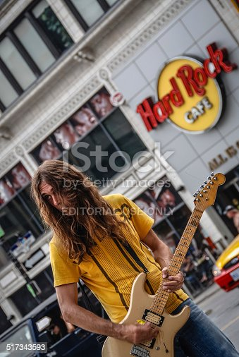 Toronto, Canada - July 5, 2010: Man playing the electric guitar on the street across from the Hard Rock cafe in downtown, Toronto, Canada.