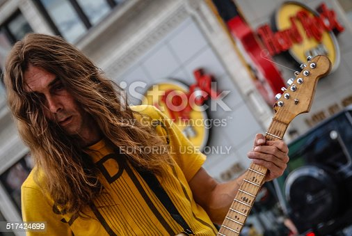Toronto, Canada - July 5, 2010: Man playing the electric guitar on the street across from the Hard Rock cafe in downtown Toronto, Canada.