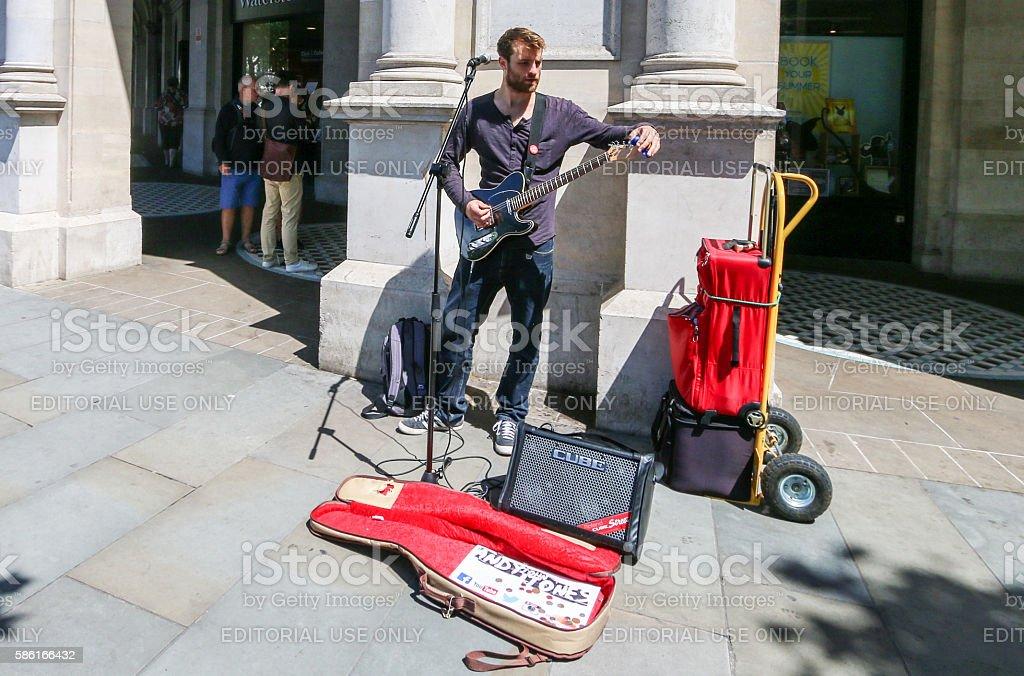 Busker in Trafalgar Square, London stock photo
