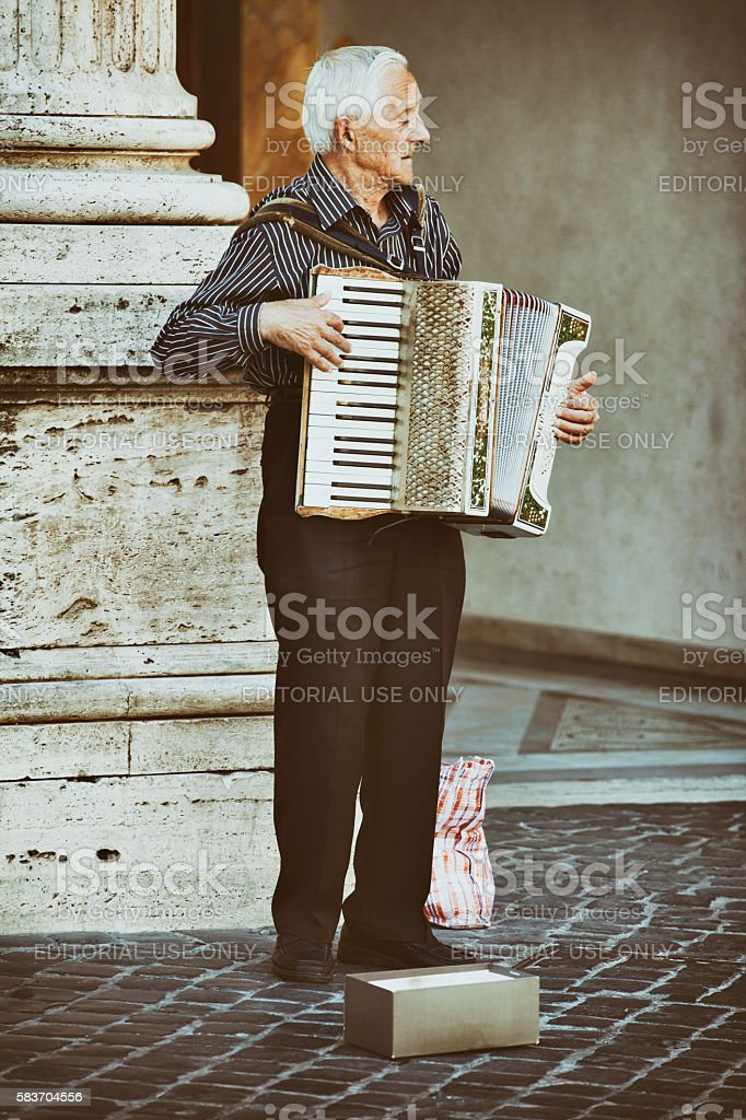 Busker playing an accordion on the street in Rome, Italy stock photo