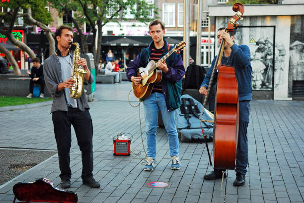 Buskers performance on Rembrandtplein in Amsterdam stock photo