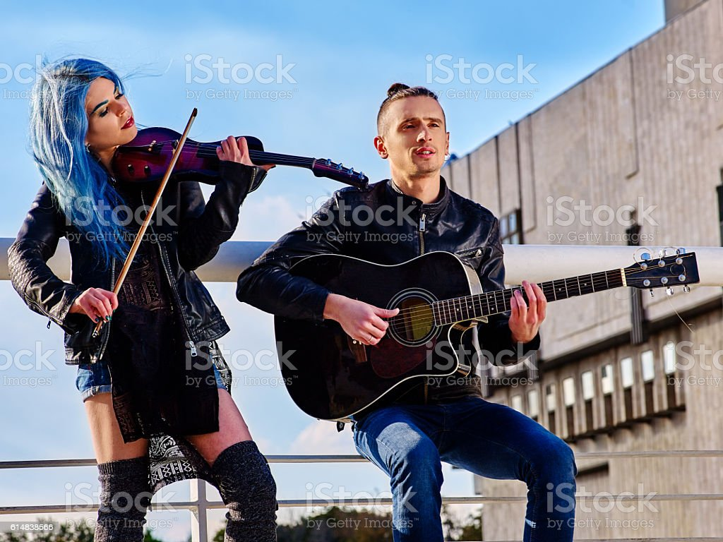 Buskers with girl violinist on roof. stock photo