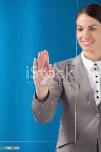 527567107 istock photo Busness woman working on transparent monitor 174922069