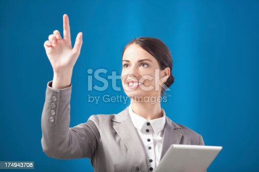 527567107 istock photo Busness woman working on transparent monitor 174943708