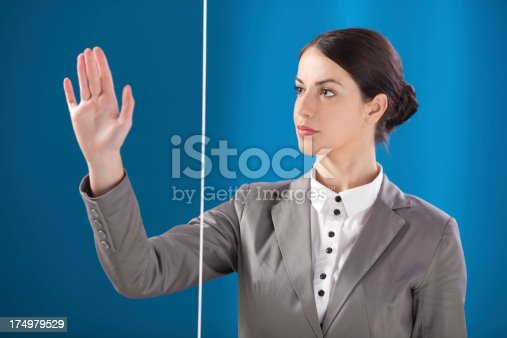 527567107 istock photo Busness woman working on transparent monitor 174979529